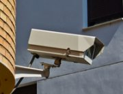 Surveillance camera on a wall of a city